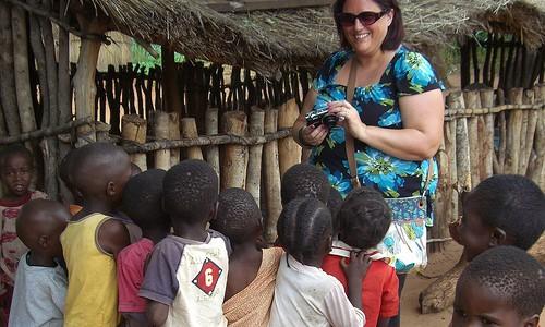 Director of Black & White with children in Mukuni Village